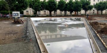 06 juillet 2018 : Réalisation de la dalle sous le miroir d'eau N°1 et du caniveau périphérique